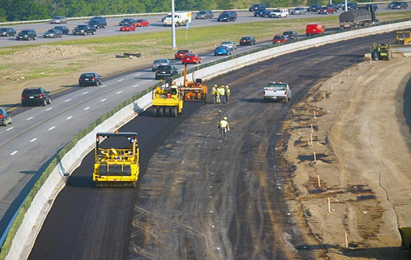 """<img src=""""encroachment.jpg"""" alt=""""paving of right side of freeway with cement barriers"""">"""