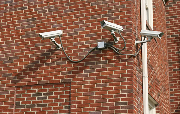"<img src=""SecurityCamerasPS.jpg"" alt=""three security cameras attached to brick wall"">"